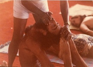 Guruji giving Prem adjustment in Rajkapotasana